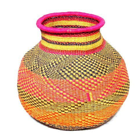 Vegan bolga vase basket handmade from Ghana's elephant grass. Looks beautiful with floral arrangements or even just sitting pretty.