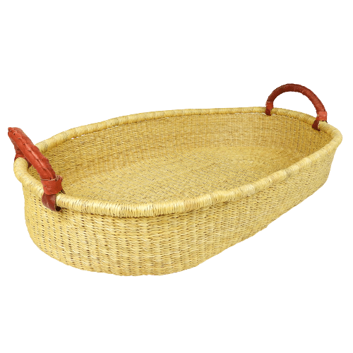 Baby change basket equipped with durable leather handles and a large surface area. Handmade in Bolgatanga, Northern Ghana.