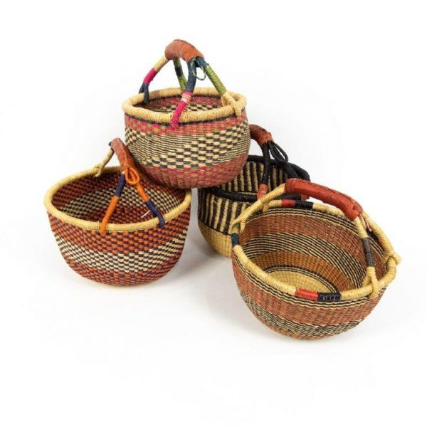 Medium round bolga baskets handmade from elephant grass and leather. Made in Ghana. Perfect for shopping or just sitting pretty.